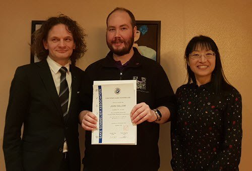John Callow Presented with Sake Certificate by Kumiko Ohta and Xavier Chapelou